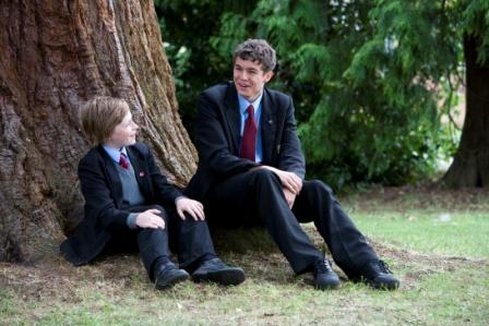 2BOYS UNDER TREE SITTING NEW LOGO.jpg